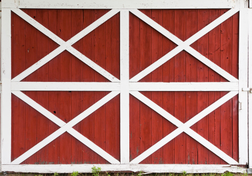 Weathered barn doors with white crossed trim