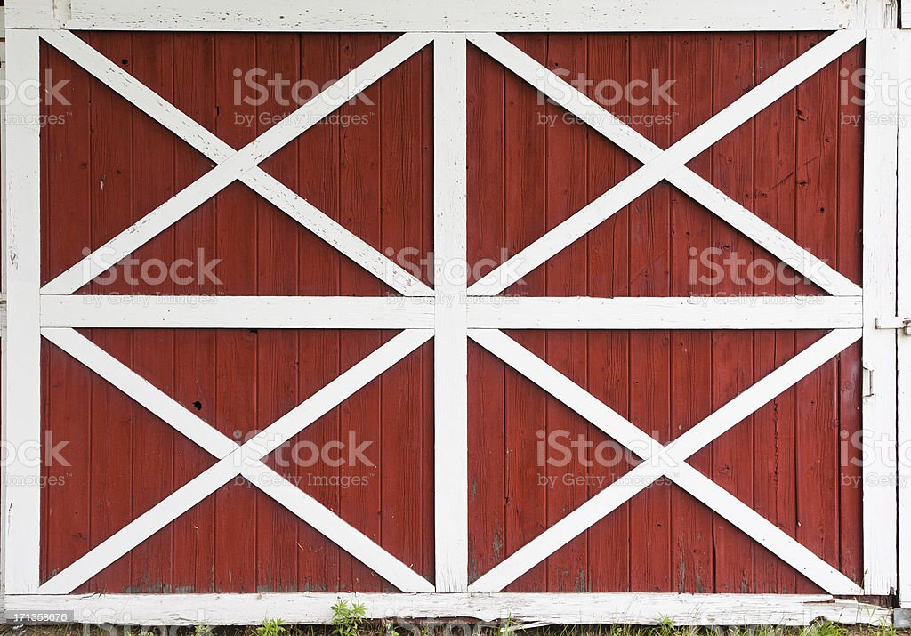 Red barn doors with white trim stock photo