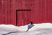An image of a two large doors on a red barn.