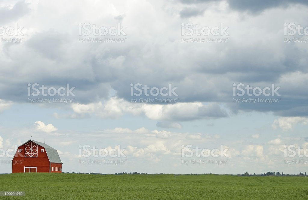 Red Barn, Heavy Clouds, and Copy Space stock photo