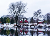 red barn house reflection in the snow