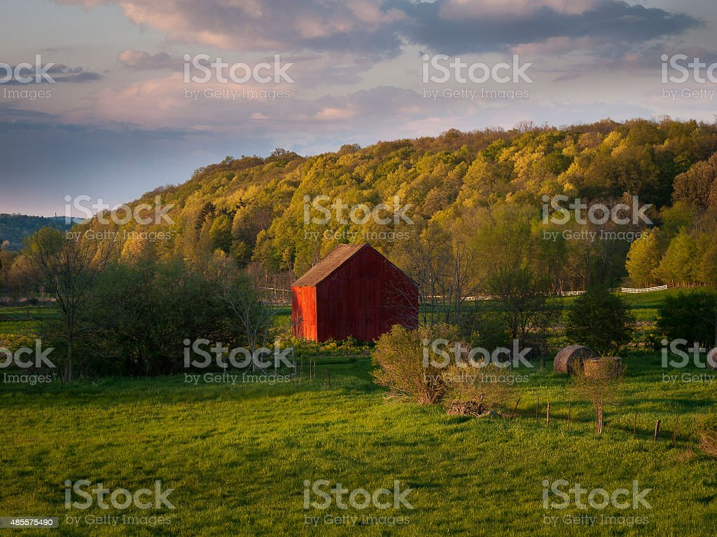 Red Barn in Spring Early Evening stock photo
