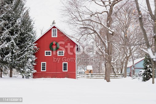 istock Red barn in the snow - rural winter scene 1141535919