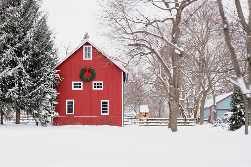 istock Red barn in the snow - rural winter scene 1141535919
