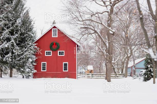 Photo of Red barn in the snow - rural winter scene