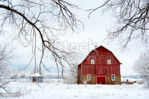 istock Red Barn in Winter 155276223