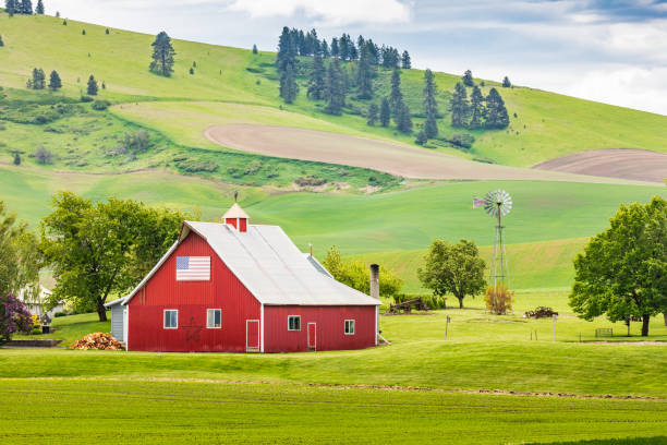 A red barn on a picturesque farm in the Palouse hills. stock photo