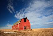 A red barn on the prairie. Alberta, Canada.