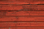 Red barn siding horizontal background with rough texture.