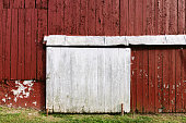 An old red barn wall background with nobody.