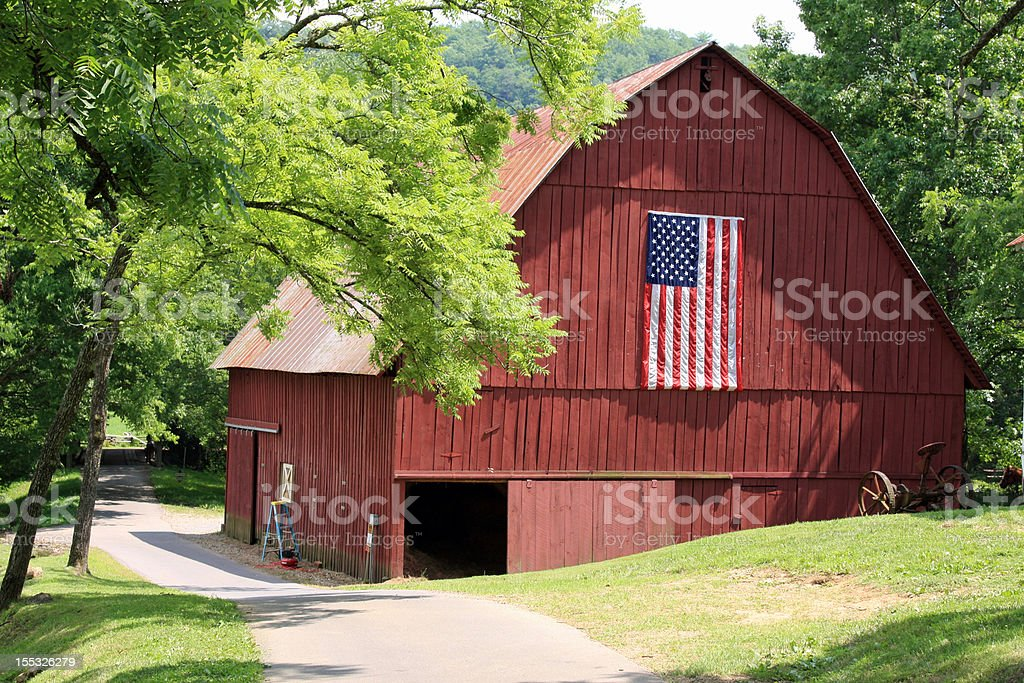 Red barn with the American Flag stock photo