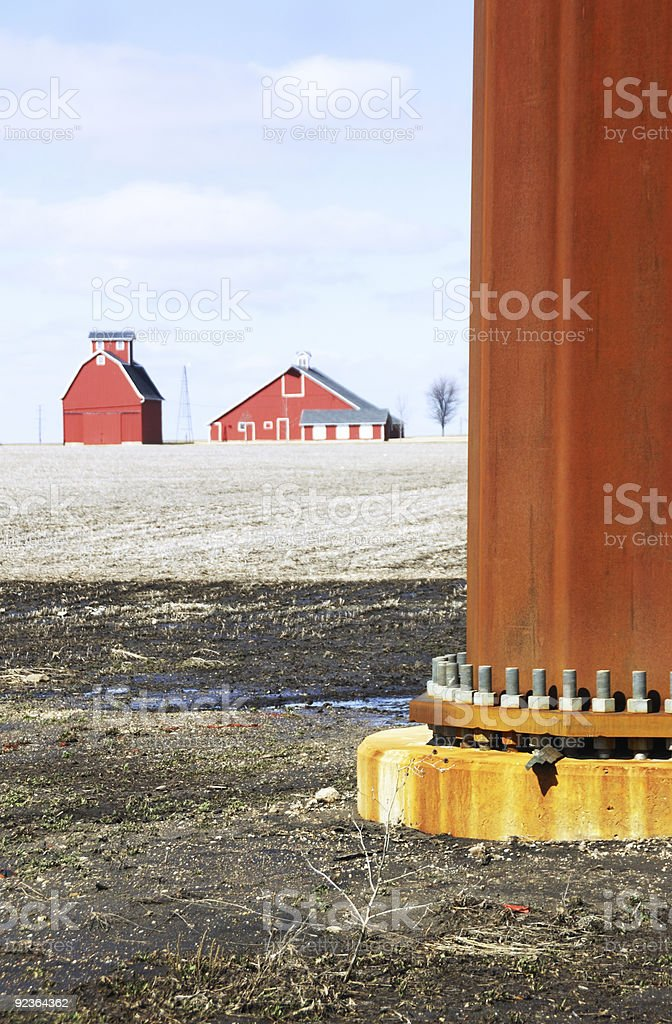 Red Barns Behind Rusty Pole royalty-free stock photo
