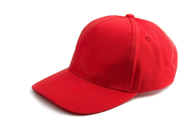 Red Baseball Cap Red Baseball Cap isolated on white baseball cap stock pictures, royalty-free photos & images