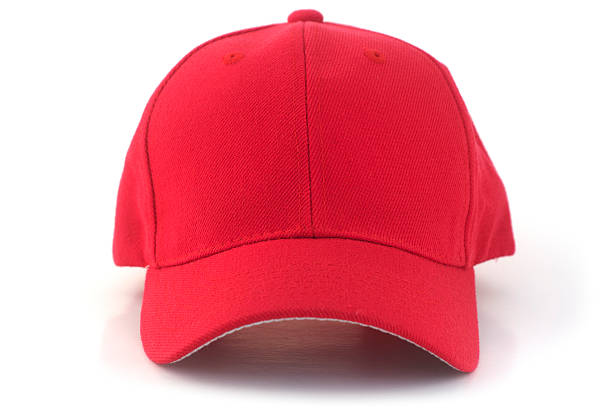 Red Baseball Cap Isolated red baseball cap on a white background. uniform cap stock pictures, royalty-free photos & images