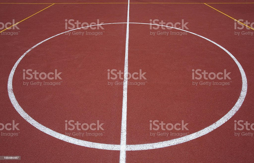 The center of a red basketball field