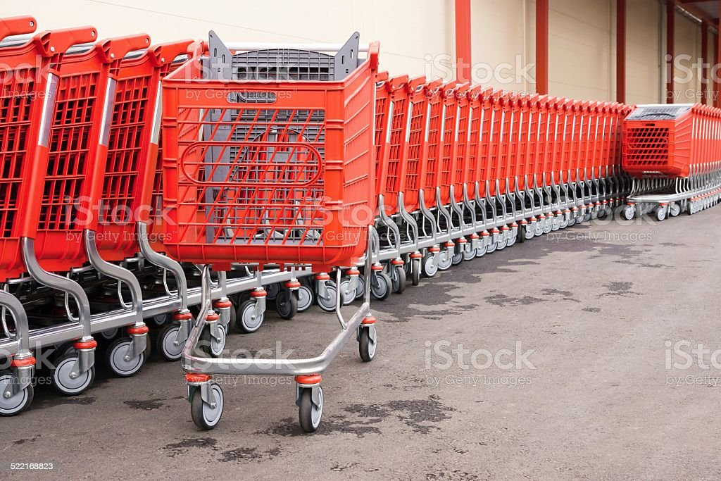 red baskets-carts on wheels for goods stock photo