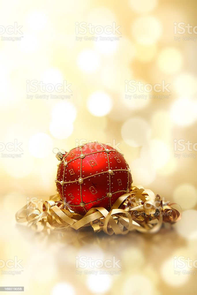 Red bauble and golden ribbon royalty-free stock photo