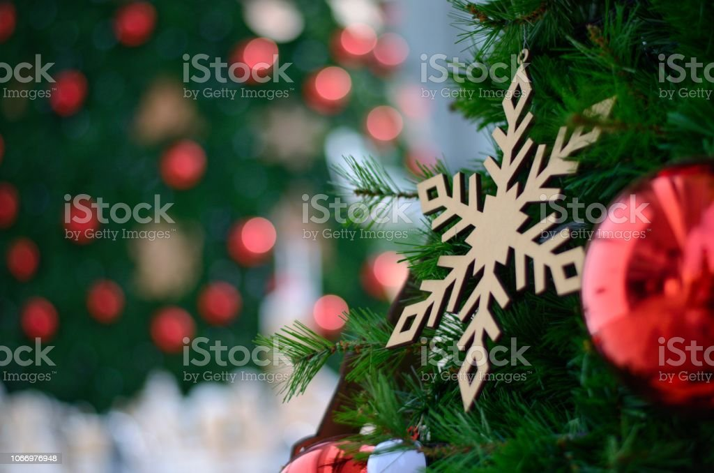 Red Bauble And Other Ornament Hanging On Christmas Tree With