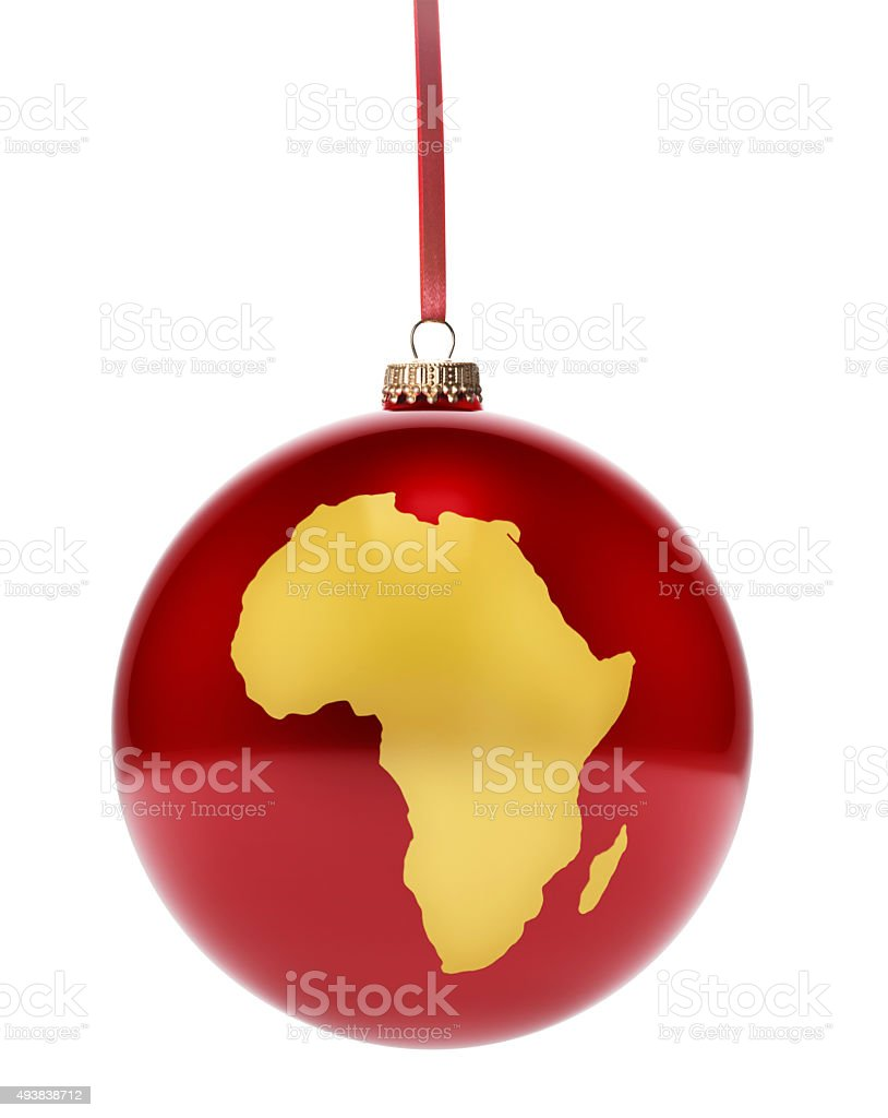 Red bauble with the golden shape of Africa.(series) stock photo