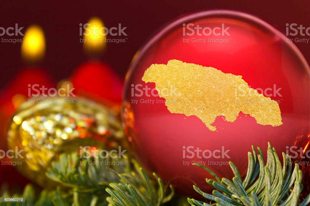 Red Bauble With The Golden Shape Of Jamaica Series Stock Photo