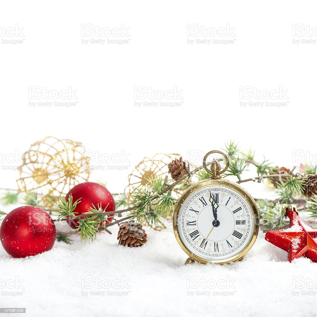 red baubles and antique golden clock in snow on white royalty-free stock photo
