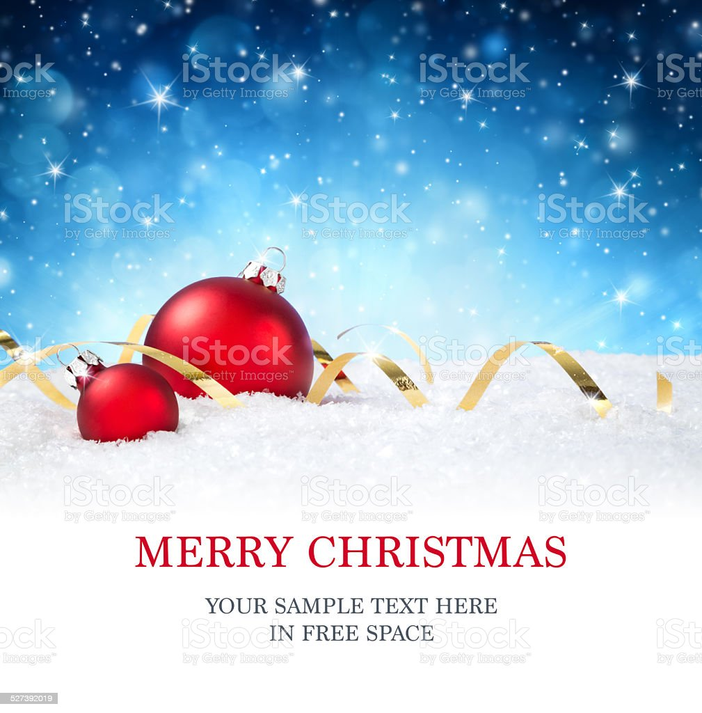 red baubles and ribbon on snow in the starry night stock photo