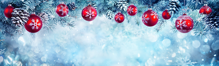 istock Red Baubles Hanging At Fir Branches 868155492