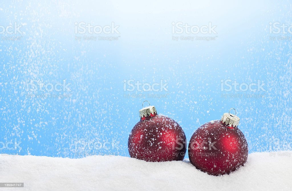 Red Baubles With Falling Snow stock photo