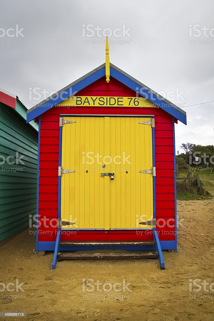 Red bayside bathing box with a yellow door royalty-free stock photo