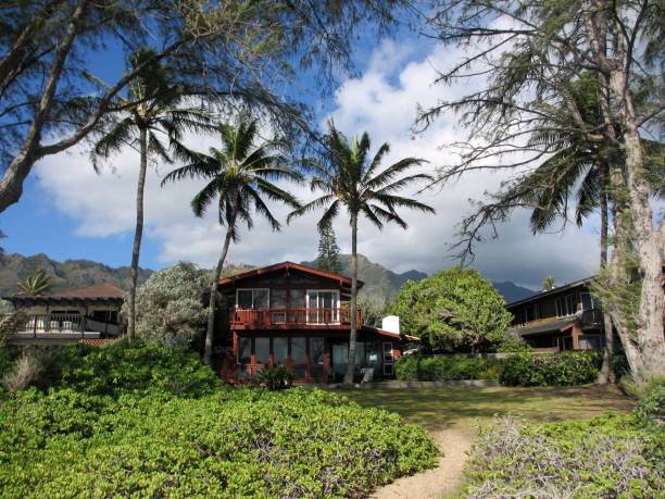 red beach house in waimanalo on a beautiful day - hawaii home stock photos and pictures