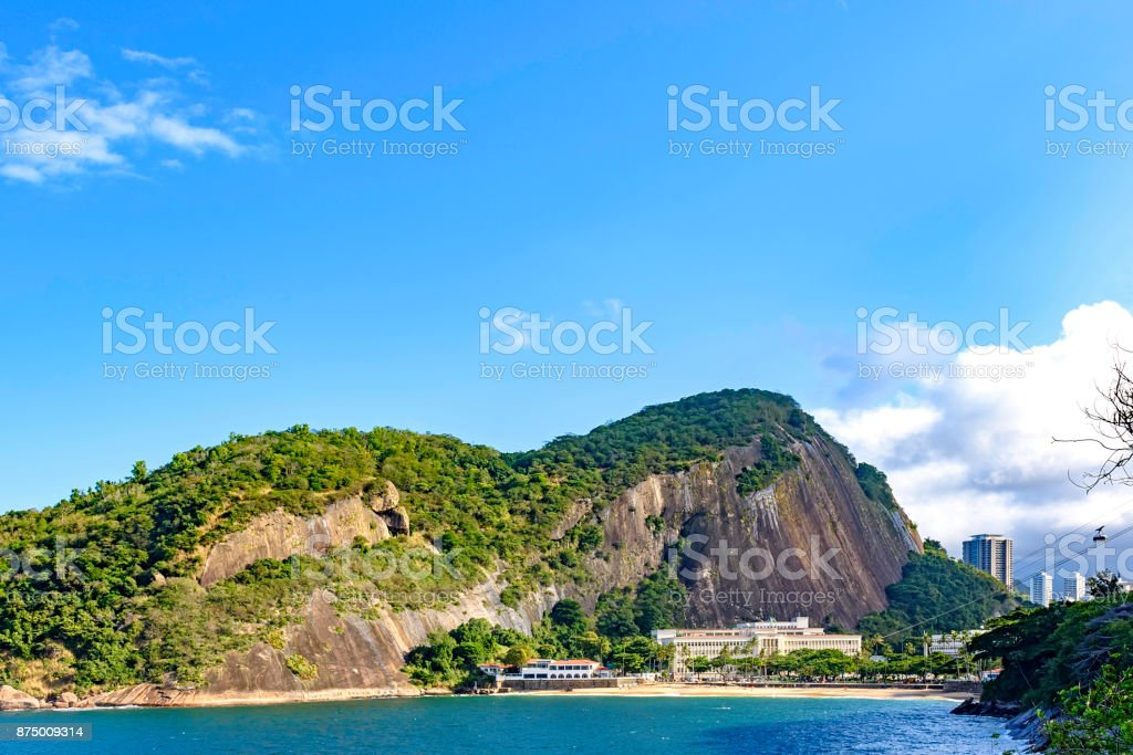 Red beach, the starting point of the Sugar Loaf hill cable car stock photo