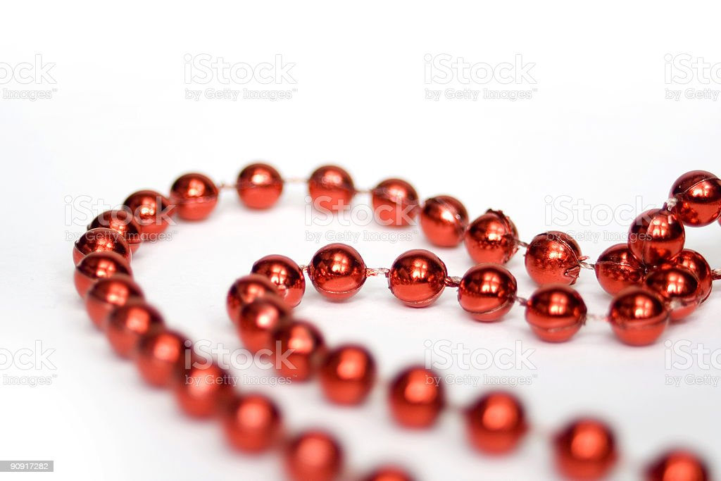 Red beads in shape of heart isolated on white royalty-free stock photo