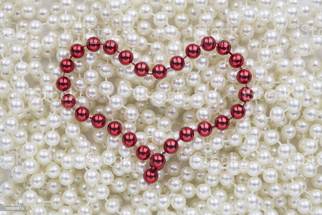 Red beads in the shape of a heart royalty-free stock photo