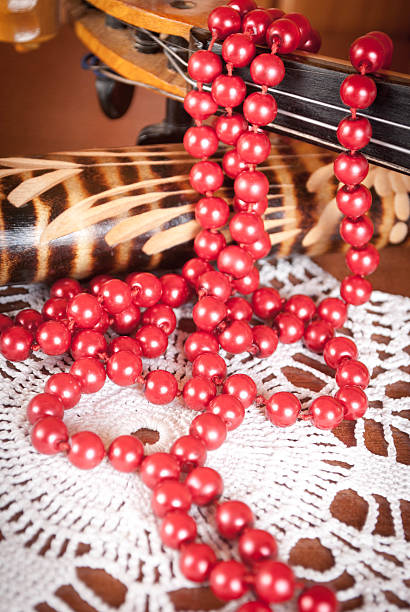 Red beads on a napkin stock photo