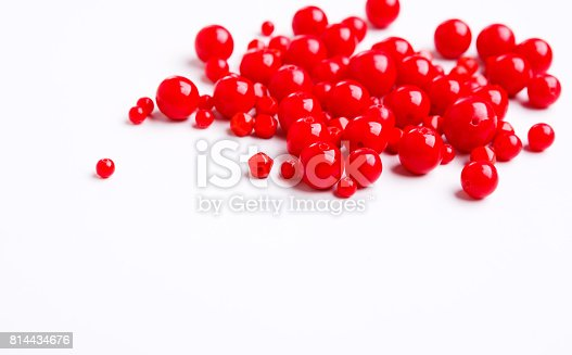 istock Red beads on white background free space 814434676