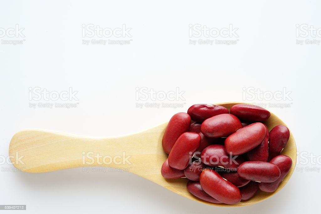 red bean whole grain on the wooden spoon. top view stock photo
