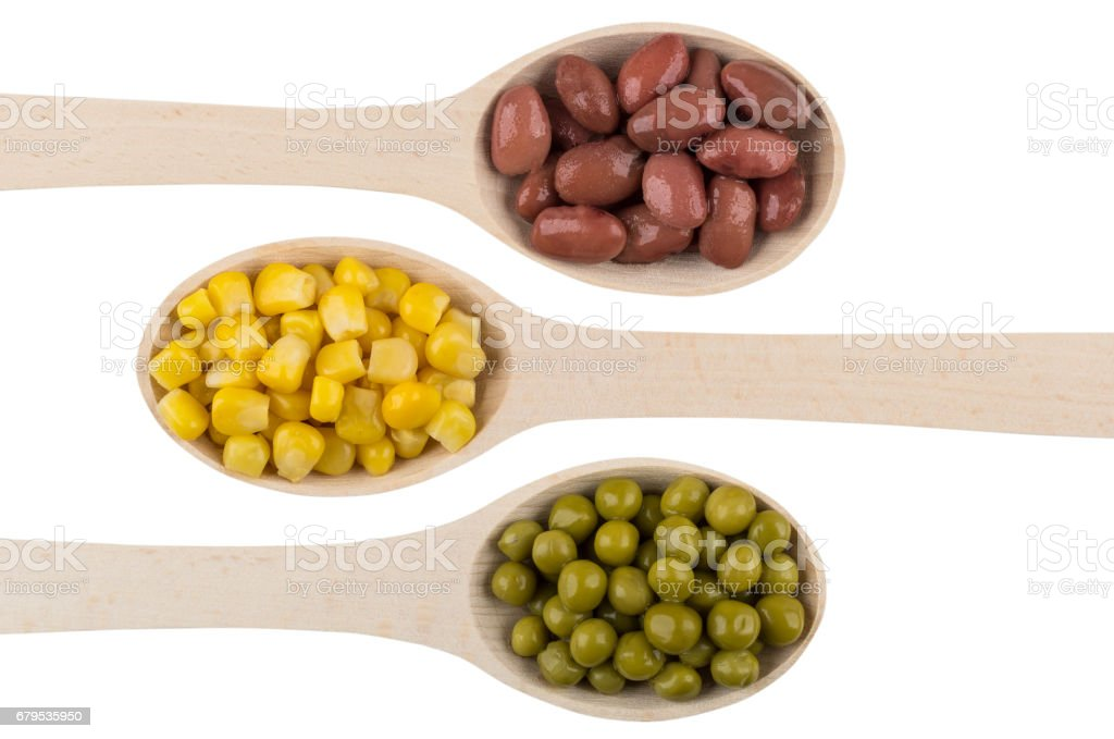 Red beans, green peas, sweet corn in wooden spoons royalty-free stock photo