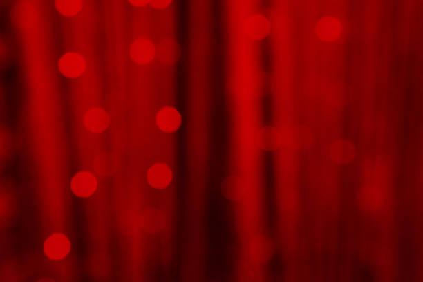 赤の美しい抽象的な背景のボケ味がぼやけ - glitter curtain ストックフォトと画像
