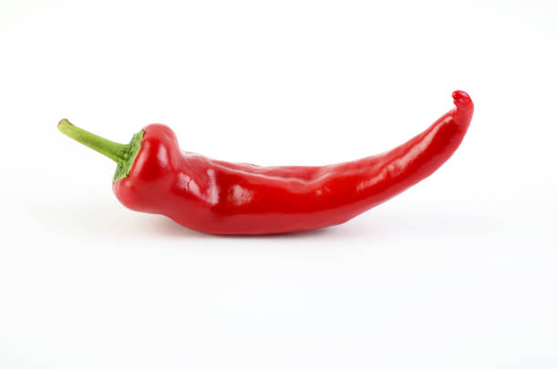 Red bell pepper on white background Red bell pepper on white background spiked stock pictures, royalty-free photos & images