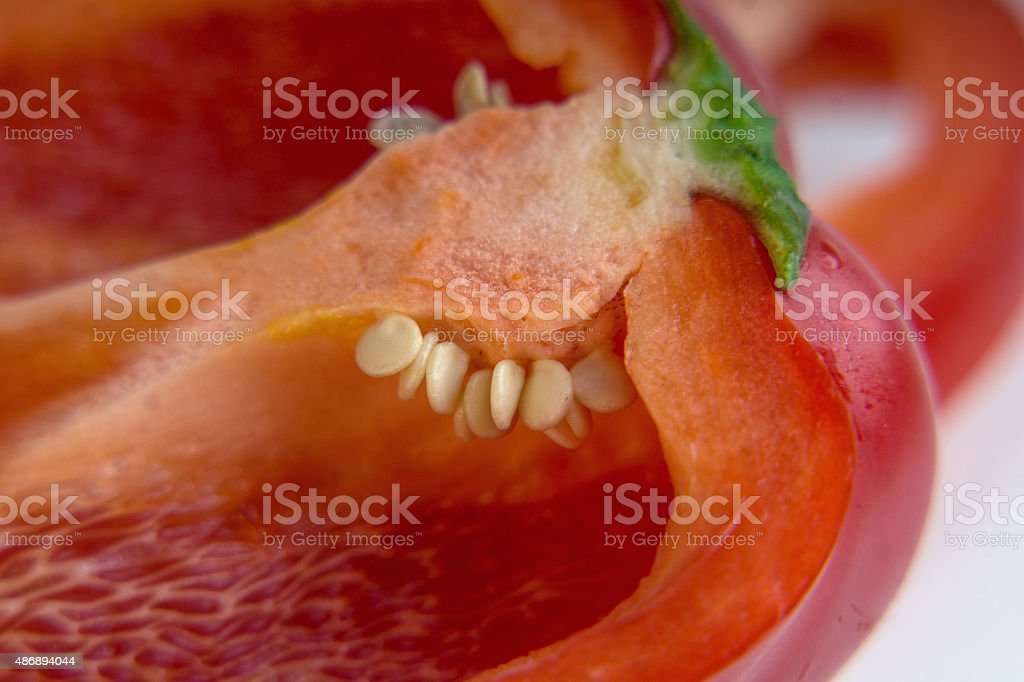 red bell pepper sliced with seeds magnified royalty-free stock photo