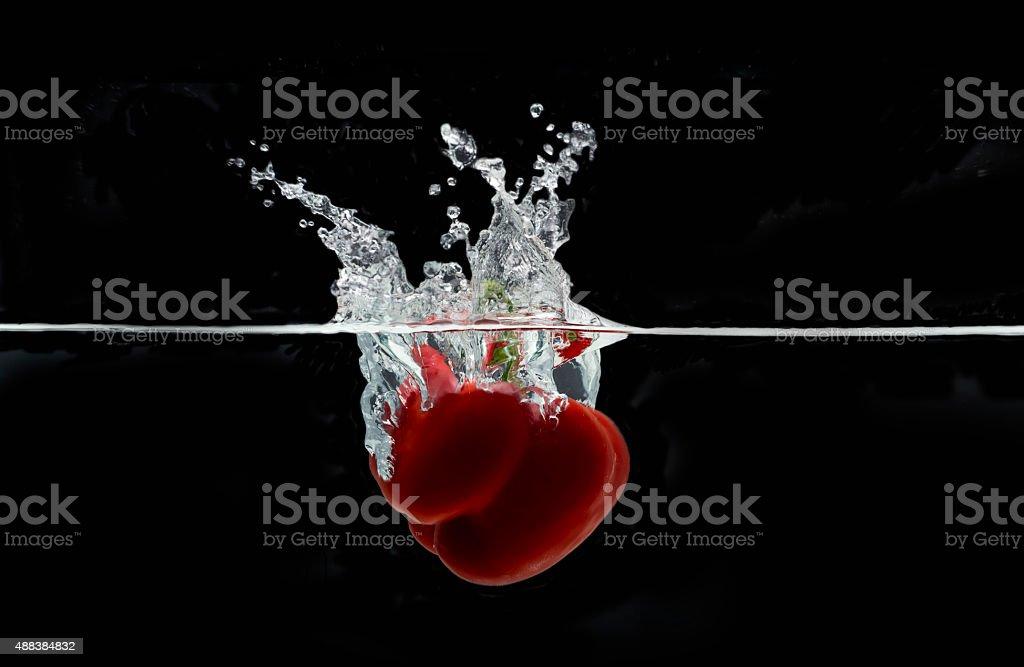 Red bell pepper splash stock photo