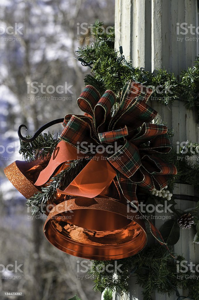Red Bells Christmas Decoration Hanging from Lamppost stock photo
