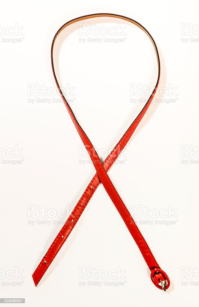 Red belt forming AIDS bow stock photo
