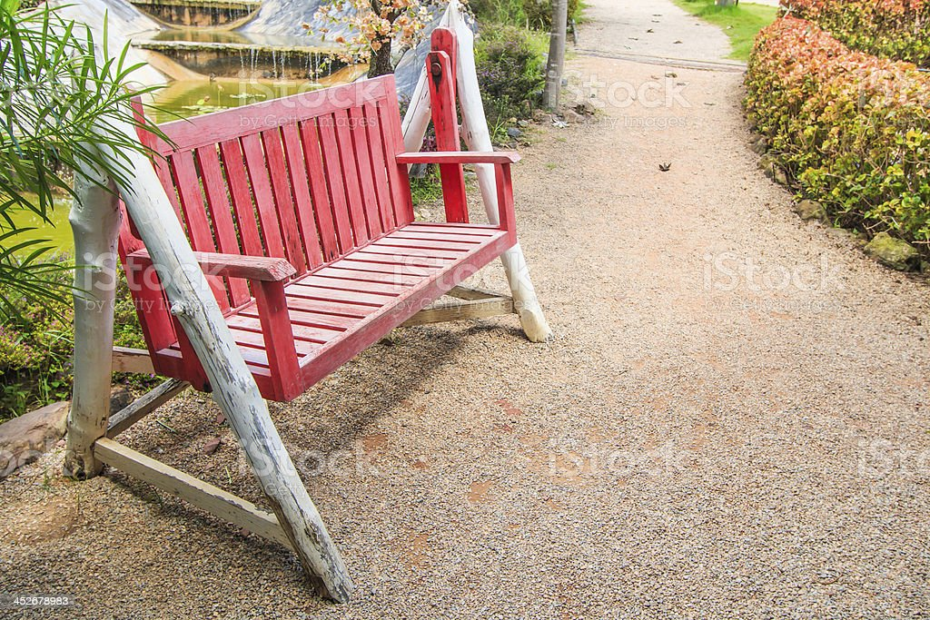 Red bench in lawn royalty-free stock photo