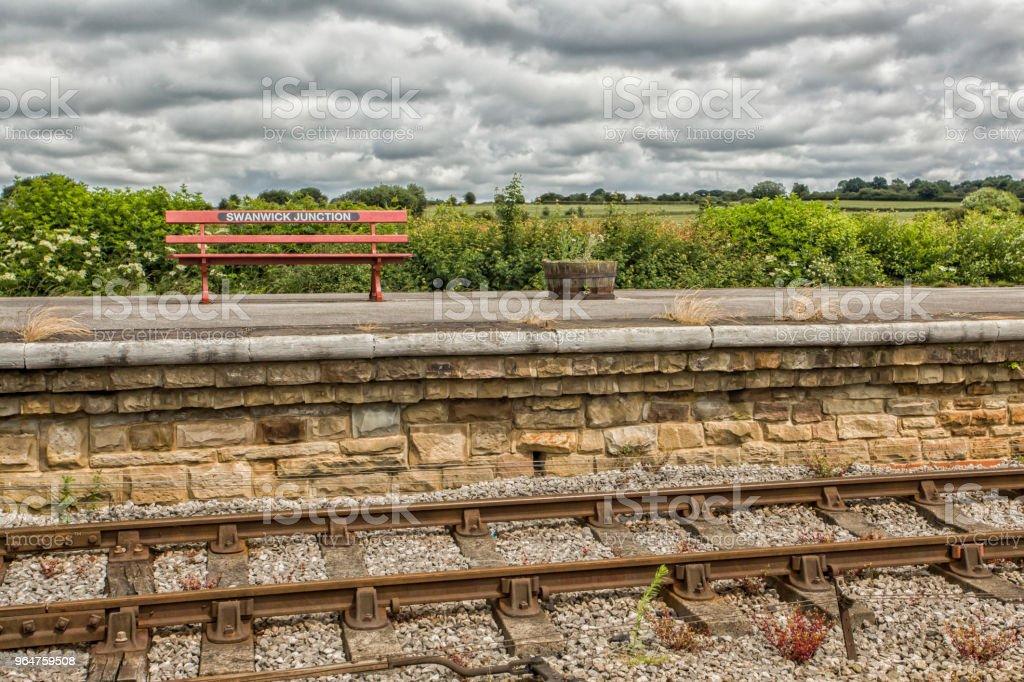 Red bench on platform royalty-free stock photo