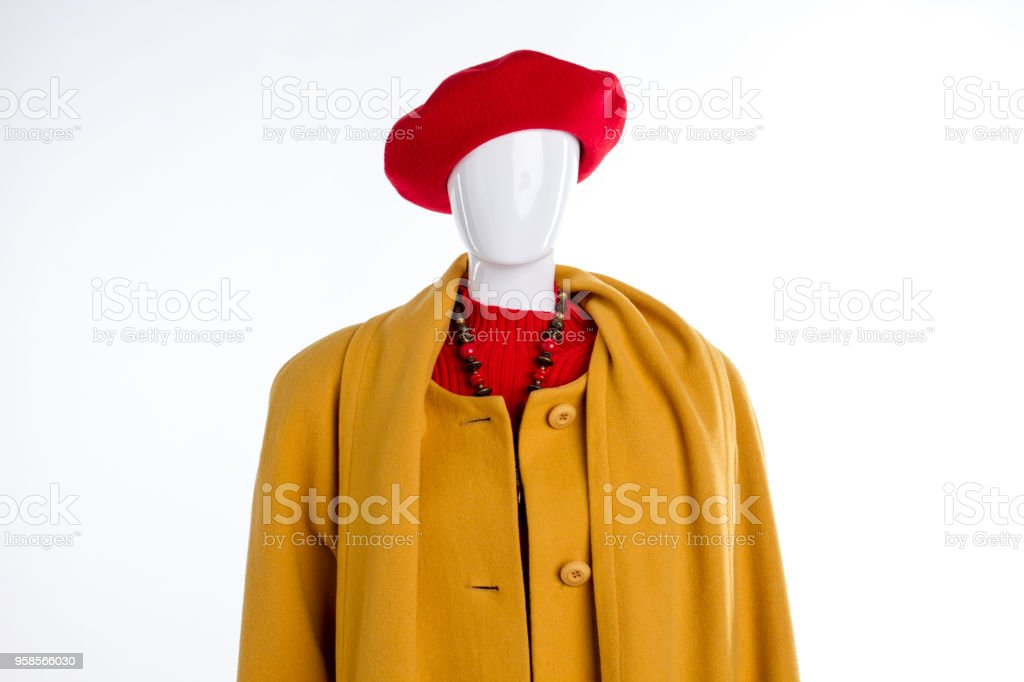Red beret and yellow coat for women. stock photo