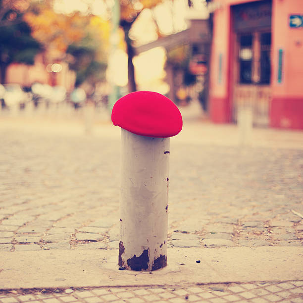 Red Beret in a bollard stock photo