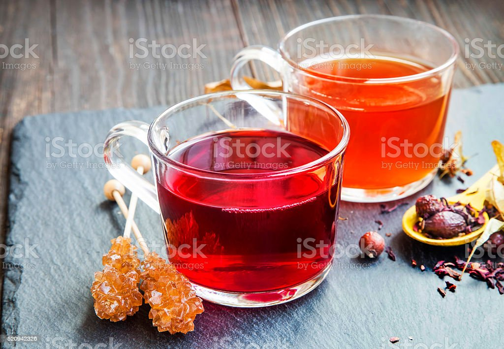 Red berries tea in transparent cups stock photo