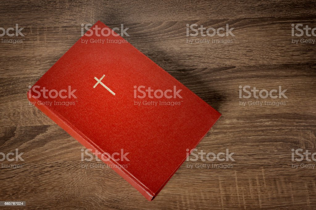 Red bible with cross on cover stock photo