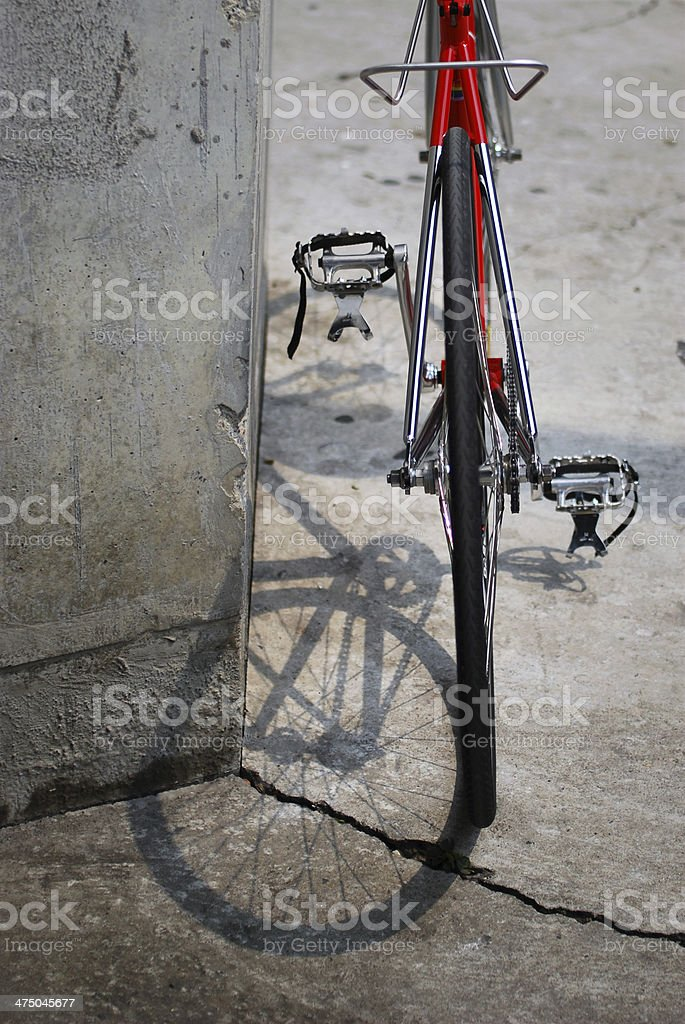 Red bicycle from behind royalty-free stock photo